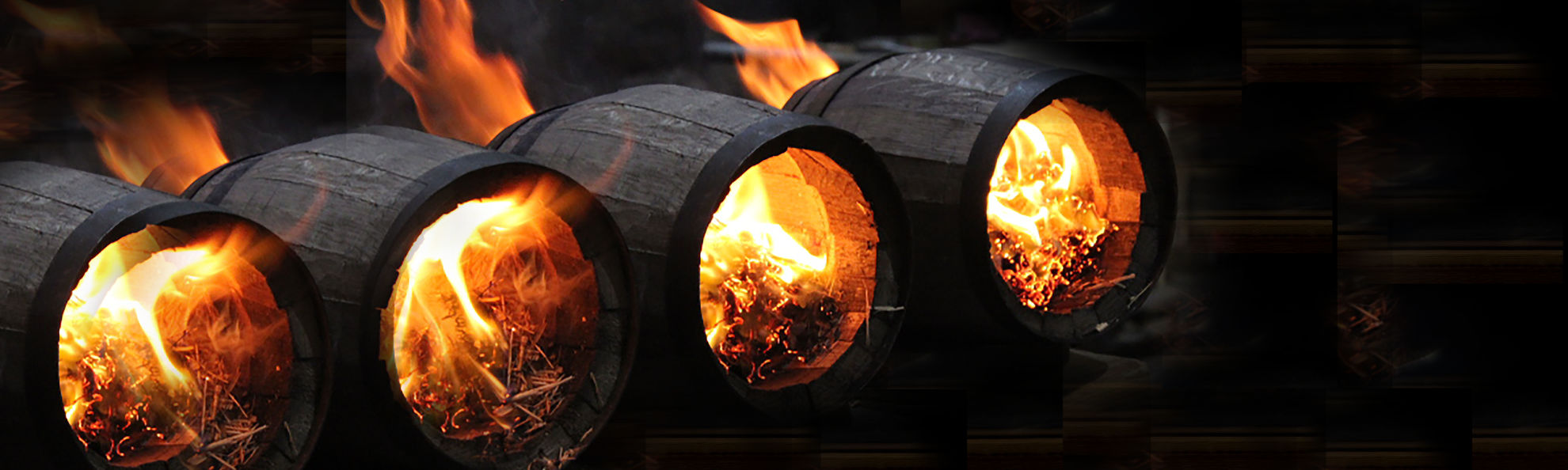 oak barrels being charred